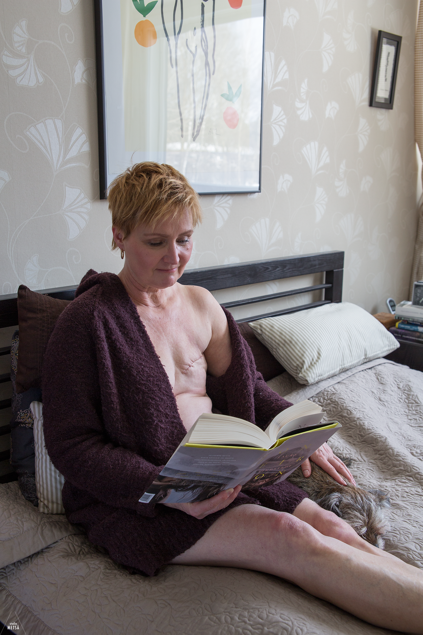 After mastectomy reading a book by Studio Metsä Photography