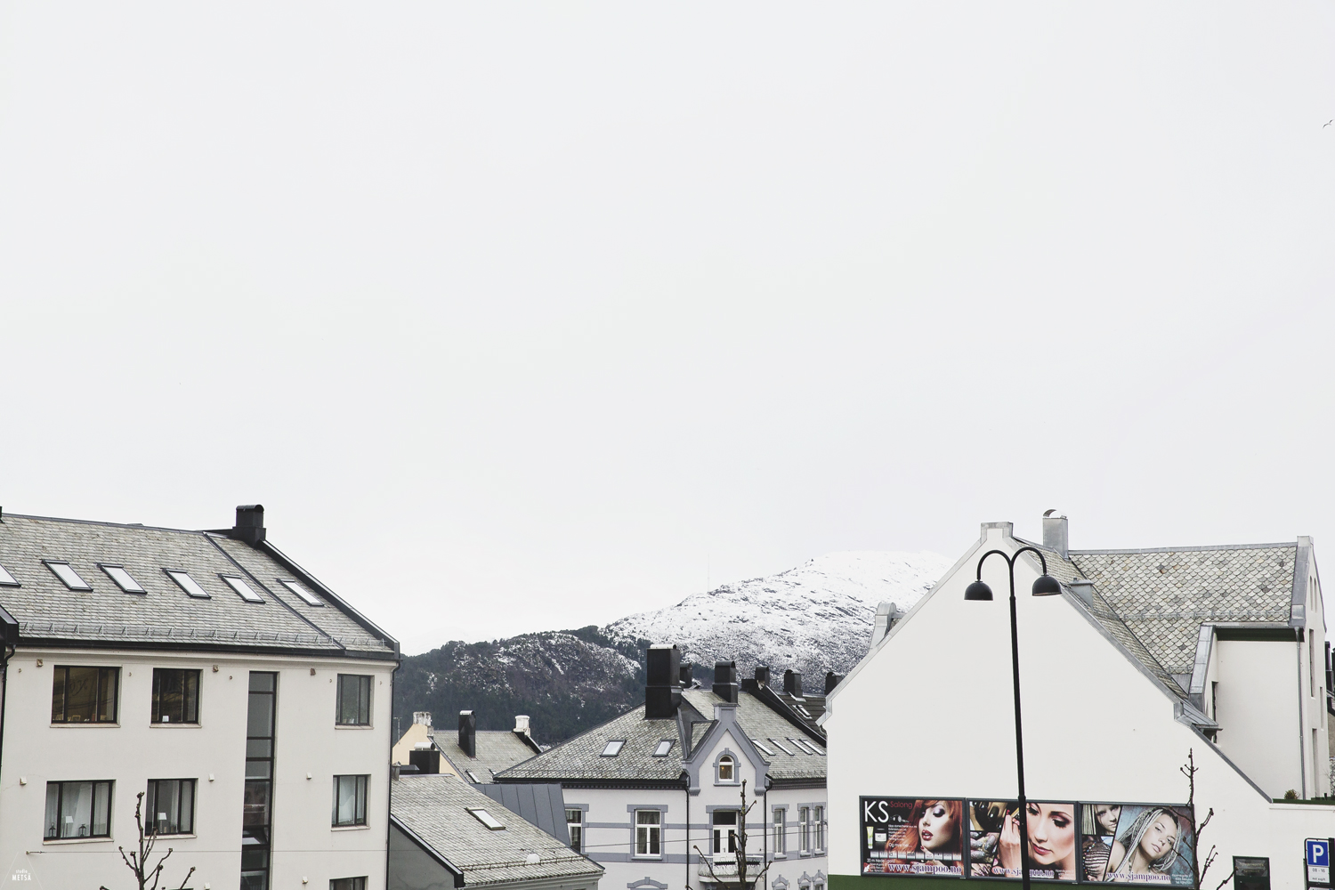 Street views with mountains in Ålesund Norway by Studio Metsä Photography